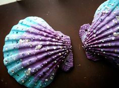 Siren's Grotto Custom MERMAID SEASHELLS Encrusted with Crystals, Pearls and Precious Notions. $200.00, via Etsy.