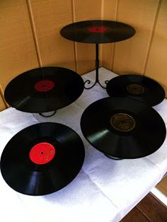 Old records glued to candlestick holders or martini glasses. Stack them for a tiered tray.