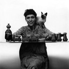 Lisa Larson with a collection of her cat figures with a siamese cat on her shoulder Lisa, Pottery Marks, Ceramic Animals, Beautiful Mind, Beautiful Cats, Cat People, Siamese Cats, Ceramic Artists, Retro