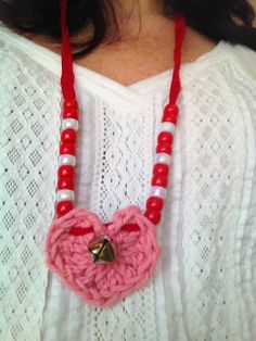 crochet a heart, add some ribbon (yarn), beads and a little bell Via timeforseason.blogspot.com