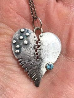 Sterling Broken and Stitched Heart Pendant with Blue Zircon