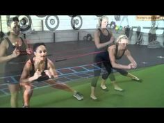 Orange County Personal Trainers Demonstrate C Band Exercises with a Partner