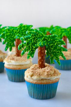 Enjoy a taste of the tropics with a recipe for the best coconut cupcakes topped with cream cheese frosting and pretzel palm trees!