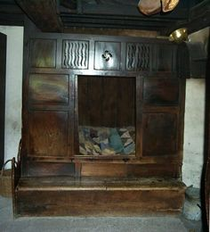 Beds enclosed within cupboards, with sliding doors and fretwork panels for ventilation, provided some privacy and extra warmth where there was no room for separate bedrooms.