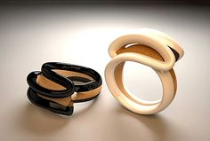 3D-modelled rings in gold and wood by Italy's D'Arc Studio.