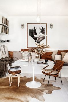 for the bonco. love the leather and linen pillows and the flour sack pillow on chair. nice with the tulip high gloss white table