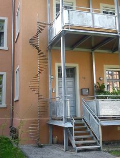 circular newel stair with metal newel and wooden steps as cat ladder in Achern, Germany