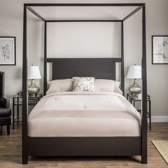 Sleek and beautiful, this stunning full canopy bed adds a sense of elegance to any room. The bed is designed with clean lines and features a solid hardwood construction and a contemporary black finish that boosts the style of any bedroom.