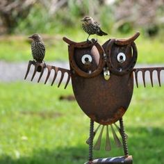 An owl sculpture made from old shovels and rakes