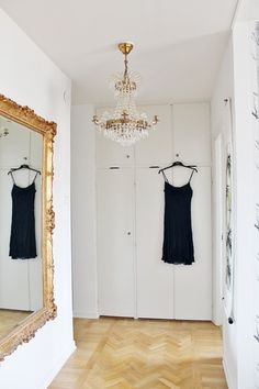 Gilded mirrors and chandeliers for the closet