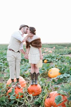 an engagement in a pumpkin patch  Photography by mallorymorganphotography.com