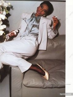 Yves Saint-Laurent 1984 Photos Guy Bourdin: All white pant suit with grey silk blouse and high heels @Coveteur