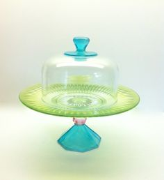 Cover Your Cupcake Hand Painted Cupcake Stand and Dome In Pastels. $30.00, via Etsy. by roberta