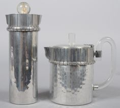 """Two Pieces of Art Deco Buenilum Aluminum with clear lucite finials and handle; Teapot, 7 3/4"""" high and Cocktail Shaker, 11"""" high. Condition: teapot is good, cocktail shaker has damage to finial"""