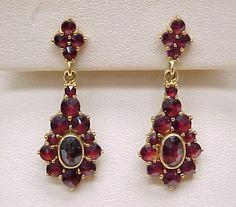 ITEM: Ornate Dangle Bohemian Garnet EarringsCOMPOSITION: 18k goldGEMS: Bohemian Garnet, rose cuts (oval & round) measuring 6 X 4 mm, 2mm to 3.7 mm.