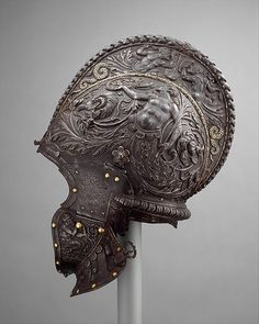 Milanese Burgonet, ca. 1550-55  Allegorical figures of Fame and Victory are embossed on the sides of the bowl. The helmet was originally fitted with a pivoting visor and plates at the nape.