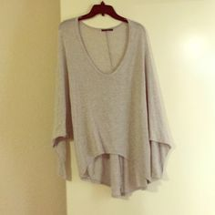 Light grey batwing top Light grey batwing top from Brandy Melville. One size fits most. Still in good condition. Worn only a handful of times. Color is light gray (last photo is the same top, diff color). Brandy Melville Sweaters