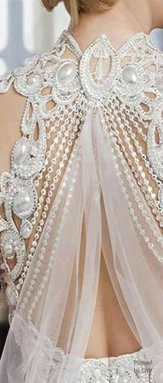 detail of dress back via Details and Close Ups ❤ | Pinterest)   Does anyone know the designer?