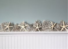 """Beach Christmas decor starfish garland using cool IVORY nautical decor netting with bonus SILVER SPARKLE and large 4-6"""" real white starfish. A nice long 10 foot size too!  Coastal decor wedding or Christmas garland, totally wired throughout so you can shape it however you'd like around anything.  The addition of the SILVER SPARKLE of tinsel woven throughout makes it extra festive and beautiful with white lights!   Free ends.  New IVORY shade PLUS SILVER SPARKLE!"""