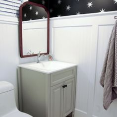 A dreary basement bathroom renovation mixes modern + vintage elements