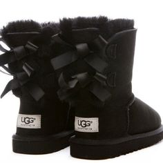 Perfect black bow uggs! Cute like new black Ugg boots with bows on the back. Worn a few times but in excellent condition! Perfect for Christmas. Size 3 in kids, equivalent to size 5 UGG Shoes Winter Rain Boots