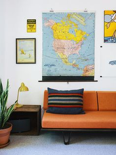 The kids' room is outfitted with a cheerful orange Case Study daybed from Modernica and a selection of vintage maps and artwork.