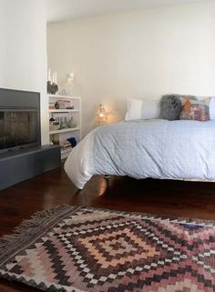 I am in love with the kilim in this picture.  Nice neutral tones, atypical for the ones I've seen.