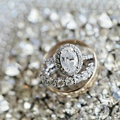 halo oval diamond engagement ring with diamond band