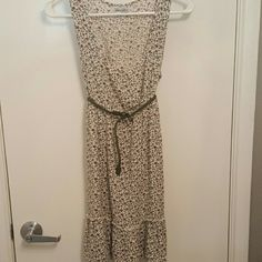 Floral sun dress with green belt Low cut floral sundress. Comes with dark green belt Dresses