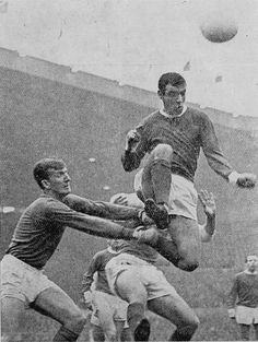 22nd March 1969. Manchester United centre half David Sadler helps out goalkeeper Alex Stepney, in a match against Sheffield Wednesday.
