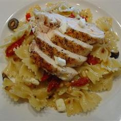 "Pasta Siciliano Allrecipes.com  By: CATHYNAN   ""This wonderful and easy skillet pasta dish includes sun-dried tomatoes, olives, pine nuts, feta cheese, and crushed red pepper flakes. This is an authentic alternative that gets rave reviews in our family."""