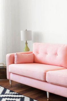 KARLSTAD SOFA IKEA HACK: Mid-Century Inspired Pink Sofa! Incredible makeover! She dyed the slip cover pink, added MCM legs and tufting to totally upgrade the look of a basic sofa.