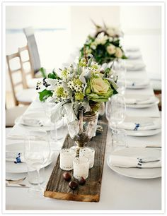 wooden plank centerpiece with antique centerpieces