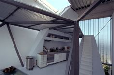 What an amazing kitchen...retractable roof and all.