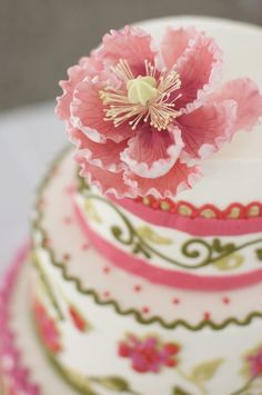 beautiful sugar flowers and embroidered ribbons on this cake...