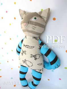 Stuffed toy cat pdf sewing pattern DIY by Joyful River on Etsy-I love the patterns on the fabric!