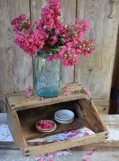 Cut pink flowers in a blue Mason jar