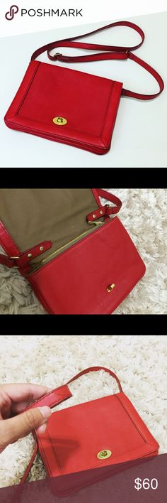 Beautiful red J. Crew purse This stylish and chic purse can be used as a clutch or a handbag. There is a slight tear on the strap and the bag is slightly worn. (Look at the pictures) However, it is barely noticeable when carried. J. Crew Bags Crossbody Bags