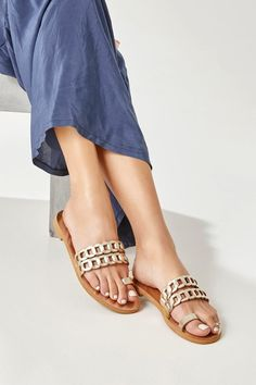 Toe ring ssummer shoes handcrafted from high-quality leather. Clean and modern design consisting of our signature chain straps and a toe loop. Aura slide sandals come in gold, silver with gold details, black, black with white, camel (waxed nubuck), blue (nubuck) with gold and white with silver details. Super comfortable yet stylish, these Women's sandals work perfectly from day to night and from the beach to the city. Greek Chic Handmades flats are designed and handcrafted in Athens, Greece.
