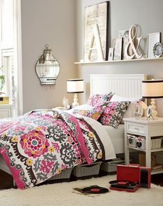 necessities: pink, orange, black, white and a bedside table for all your books
