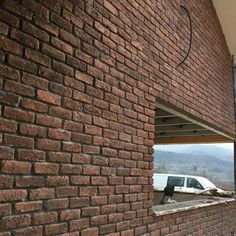 Chicago Rojo Brick Slips used to great effect on an external wall in Wales
