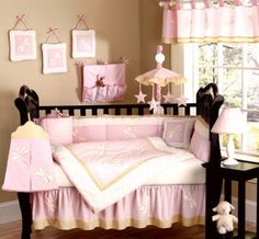 Pink Nursery- like how the room color is a tan and then all of the decor is pink so the room doesn't go overboard with pink