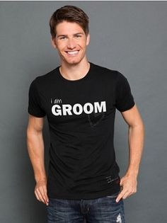 """For the husband-to-be who's about to put a ring on it, there's the I am Groom Crew T-Shirt. It may not be formal wear, but this casual tee keeps it black (tie very optional) with an inky shade and classic fit. Plus, nothing says """"He's Mine!"""" than with cheeky details like """"I am Groom"""" printed on front with a stitch Happy symbol accent, PLW quote and signature red dash marks at bottom left, """"I am Taken"""" on back, and an inspirational quote at center back."""