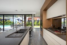 Rich timber frame anchors each end of this galley style kitchen. Each end houses Sub Zero/Wolfe appliances including integrated fridge/freezer. Island bench waterfall end is open for casual seating both sides Interior Designers Melbourne, Modern Kitchen Renovation, Integrated Fridge, Galley Style Kitchen, Quality Kitchens, Joinery, Building Design, Island Bench, House Design