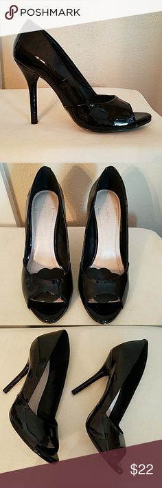 BCBGENERATION  heels BCBGENERATION shiny black peep toe heels.   In good used condition. Heels have a few scuffs but are not noticeable when worn. Size 8B BCBGeneration Shoes Heels