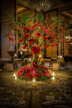 Beautiful Wedding Centerpiece - red rose tree centerpiece with hanging candles.
