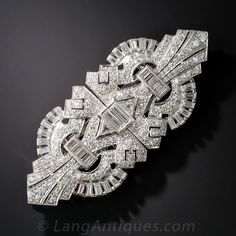 Art Deco Platinum and Diamond Clips/Brooch. A bright and brilliant collage of geometric patterns sparkles mightily with 6.35 carats of round, triangle and straight baguette-cut diamonds, in this spectacular double diamond clip brooch, reminiscent of Golden Age Hollywood glamour when this stunning 1920s Art Deco original was created. The sizable brooch measures 2 5/8 inches across and 1 1/8 inch high