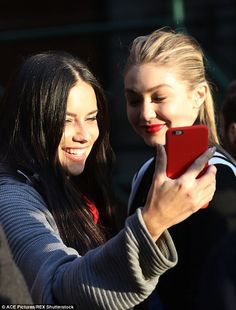 Practice makes perfect: The two appeared to be attempting another selfie...