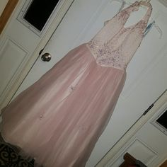 Prom/pageant gown Super sweet and elegant.  Always got so many complements when I used to wear it. Light pink satin bodice with light purple embroidery.  Light pink tuelling on the bottom.  Added abs crystals.  Really so beautiful in person. Some make up on interior of neck There have been over $100. Of crystals added to the gown Bridal Originals  Dresses Prom