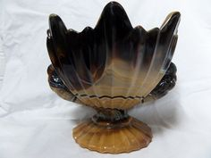 The handles are made of two modulated birds. The bowl is reminiscent of French Art Nouveau  The height of this bowl is ca.16 cm, its width 18 cm and its weight ca.1.50 kg.  Small chip of foot, see last photo.